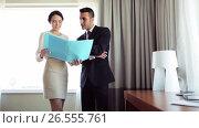 Купить «business team with papers working at hotel room», видеоролик № 26555761, снято 7 июня 2017 г. (c) Syda Productions / Фотобанк Лори