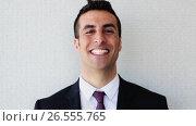 Купить «happy smiling businessman or man in suit», видеоролик № 26555765, снято 8 декабря 2019 г. (c) Syda Productions / Фотобанк Лори