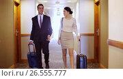 Купить «business team with travel bags at hotel corridor», видеоролик № 26555777, снято 16 июля 2019 г. (c) Syda Productions / Фотобанк Лори