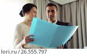 Купить «business team with papers working at hotel room», видеоролик № 26555797, снято 25 июня 2019 г. (c) Syda Productions / Фотобанк Лори