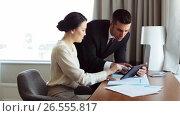 Купить «business team with papers and tablet pc at hotel», видеоролик № 26555817, снято 27 мая 2017 г. (c) Syda Productions / Фотобанк Лори