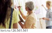 Купить «group of students painting at art school studio», видеоролик № 26561561, снято 14 октября 2019 г. (c) Syda Productions / Фотобанк Лори