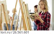 Купить «group of students painting at art school studio», видеоролик № 26561601, снято 27 мая 2017 г. (c) Syda Productions / Фотобанк Лори