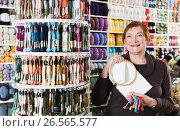 Купить «Woman buying embroidery accessories», фото № 26565577, снято 10 мая 2017 г. (c) Яков Филимонов / Фотобанк Лори