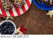 Купить «Various sweet foods arranged on wooden table», фото № 26569213, снято 10 февраля 2017 г. (c) Wavebreak Media / Фотобанк Лори