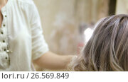 Купить «Styling a client's hair in beauty salon», видеоролик № 26569849, снято 12 июня 2017 г. (c) Константин Мерцалов / Фотобанк Лори