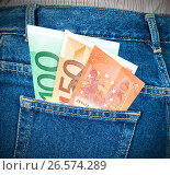 Euro banknotes sticking out of the back jeans pocket. Money for travel and shopping, фото № 26574289, снято 20 июля 2017 г. (c) FotograFF / Фотобанк Лори
