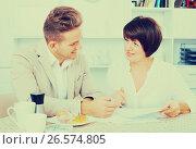 Купить «Man and woman work with papers», фото № 26574805, снято 17 октября 2018 г. (c) Яков Филимонов / Фотобанк Лори
