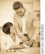 Купить «Son telling elderly mother how to use phone», фото № 26574821, снято 8 июля 2020 г. (c) Яков Филимонов / Фотобанк Лори