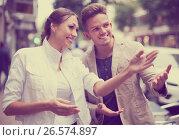 Woman showing direction to guy. Стоковое фото, фотограф Яков Филимонов / Фотобанк Лори