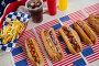 American flag and hot dogs on wooden table, фото № 26576333, снято 10 февраля 2017 г. (c) Wavebreak Media / Фотобанк Лори