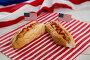 American flag and hot dogs on wooden table, фото № 26577149, снято 10 февраля 2017 г. (c) Wavebreak Media / Фотобанк Лори