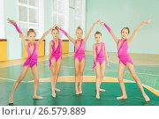 Купить «Girls doing rhythmic gymnastics in sports hall», фото № 26579889, снято 16 апреля 2017 г. (c) Сергей Новиков / Фотобанк Лори