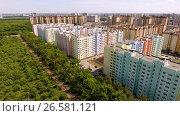 Купить «Aerial view of new housing estate in the russian city - Voronezh. 4K», видеоролик № 26581121, снято 12 июня 2017 г. (c) ActionStore / Фотобанк Лори