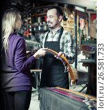 Купить «Young man worker assisting female customer in choosing belt», фото № 26581733, снято 21 августа 2019 г. (c) Яков Филимонов / Фотобанк Лори