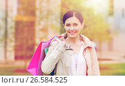 Купить «smiling woman with shopping bags coming from sale», фото № 26584525, снято 10 мая 2015 г. (c) Syda Productions / Фотобанк Лори
