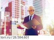 Купить «senior businessman with ring binder folder in city», фото № 26584601, снято 16 июля 2016 г. (c) Syda Productions / Фотобанк Лори