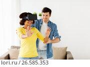 Купить «happy couple with virtual reality headset at home», фото № 26585353, снято 4 февраля 2017 г. (c) Syda Productions / Фотобанк Лори