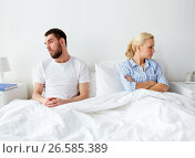 Купить «unhappy couple having conflict in bed at home», фото № 26585389, снято 11 февраля 2017 г. (c) Syda Productions / Фотобанк Лори