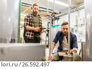 Купить «men with tablet pc at craft beer brewery filter», фото № 26592497, снято 24 марта 2017 г. (c) Syda Productions / Фотобанк Лори