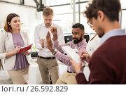 Купить «happy business team discussing something at office», фото № 26592829, снято 1 октября 2016 г. (c) Syda Productions / Фотобанк Лори