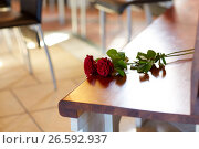Купить «red roses on bench at funeral in church», фото № 26592937, снято 20 марта 2017 г. (c) Syda Productions / Фотобанк Лори