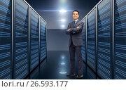 Купить «smiling businessman over server room background», фото № 26593177, снято 29 января 2015 г. (c) Syda Productions / Фотобанк Лори
