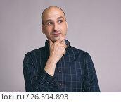 minded man in shirt touching his chin. Стоковое фото, фотограф Александр Лычагин / Фотобанк Лори