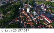 Купить «Обзор сверху старой части города с башней Олафа. Старый Таллин, Эстония», видеоролик № 26597617, снято 29 июня 2017 г. (c) Кекяляйнен Андрей / Фотобанк Лори