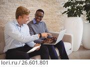 Купить «Smiling executives discussing over laptop», фото № 26601801, снято 5 марта 2017 г. (c) Wavebreak Media / Фотобанк Лори