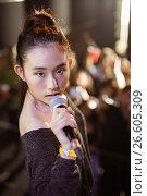 Купить «Portrait of young singer performing at music festival», фото № 26605309, снято 7 марта 2017 г. (c) Wavebreak Media / Фотобанк Лори