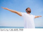 Купить «Man with arms outstretched exercising at beach», фото № 26605709, снято 17 января 2017 г. (c) Wavebreak Media / Фотобанк Лори
