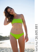 Купить «Portrait of young woman wearing bikini at beach», фото № 26605881, снято 17 января 2017 г. (c) Wavebreak Media / Фотобанк Лори