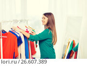 Купить «happy woman choosing clothes at home wardrobe», фото № 26607389, снято 19 февраля 2016 г. (c) Syda Productions / Фотобанк Лори