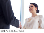 Купить «smiling business people shaking hands at office», фото № 26607633, снято 22 мая 2017 г. (c) Syda Productions / Фотобанк Лори