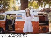 Купить «Woman with arms outstretched standing by van», фото № 26608777, снято 9 марта 2017 г. (c) Wavebreak Media / Фотобанк Лори