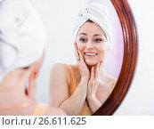Купить «Woman having a look at her face at the mirror», фото № 26611625, снято 5 июля 2020 г. (c) Яков Филимонов / Фотобанк Лори
