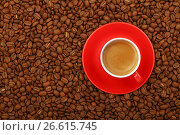 Espresso in red cup with saucer on coffee beans. Стоковое фото, фотограф Anton Eine / Фотобанк Лори