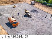 Купить «The construction of the school stadium. Excavator, dumper, roller», фото № 26624469, снято 18 мая 2017 г. (c) Алексей Трегубов / Фотобанк Лори