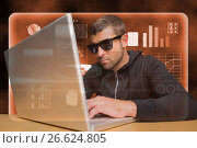 Купить «Hacker using a laptop on orange interface», фото № 26624805, снято 22 августа 2018 г. (c) Wavebreak Media / Фотобанк Лори