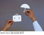 Купить «Hands holding umbrella and suitcase in paper», фото № 26624937, снято 21 мая 2018 г. (c) Wavebreak Media / Фотобанк Лори