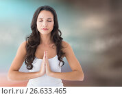 Купить «Woman meditating against blurry blue and brown background», фото № 26633465, снято 15 декабря 2018 г. (c) Wavebreak Media / Фотобанк Лори