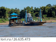 Купить «View of a car ferry on the Mekong River at Luang Prabang in Central Laos.», фото № 26635473, снято 22 января 2017 г. (c) age Fotostock / Фотобанк Лори