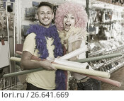 Купить «Young couple with firecrackers in hands is grimacing on camera», фото № 26641669, снято 11 апреля 2017 г. (c) Яков Филимонов / Фотобанк Лори