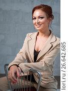 Купить «Woman in fashionable beige pantsuit in studio», фото № 26642685, снято 21 июня 2017 г. (c) Гурьянов Андрей / Фотобанк Лори