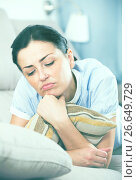 Купить «Portrait of gloomy young woman with pillow», фото № 26649729, снято 2 июня 2017 г. (c) Яков Филимонов / Фотобанк Лори
