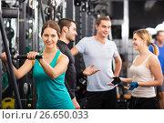 Купить «Adults having strength training», фото № 26650033, снято 7 июля 2020 г. (c) Яков Филимонов / Фотобанк Лори