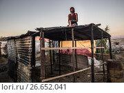 Купить «African migrants try to rebuilt the shacks in the tent camp at San Ferdinando Reggio Calabria, ITALY-09-07-2017.», фото № 26652041, снято 9 июля 2017 г. (c) age Fotostock / Фотобанк Лори