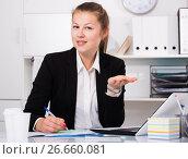 Купить «Female office worker is going to meet first visitors», фото № 26660081, снято 17 ноября 2018 г. (c) Яков Филимонов / Фотобанк Лори