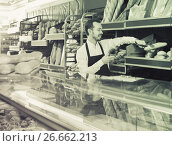 Купить «Male shop assistant demonstrating delicious loaves of bread in bakery», фото № 26662213, снято 26 января 2017 г. (c) Яков Филимонов / Фотобанк Лори